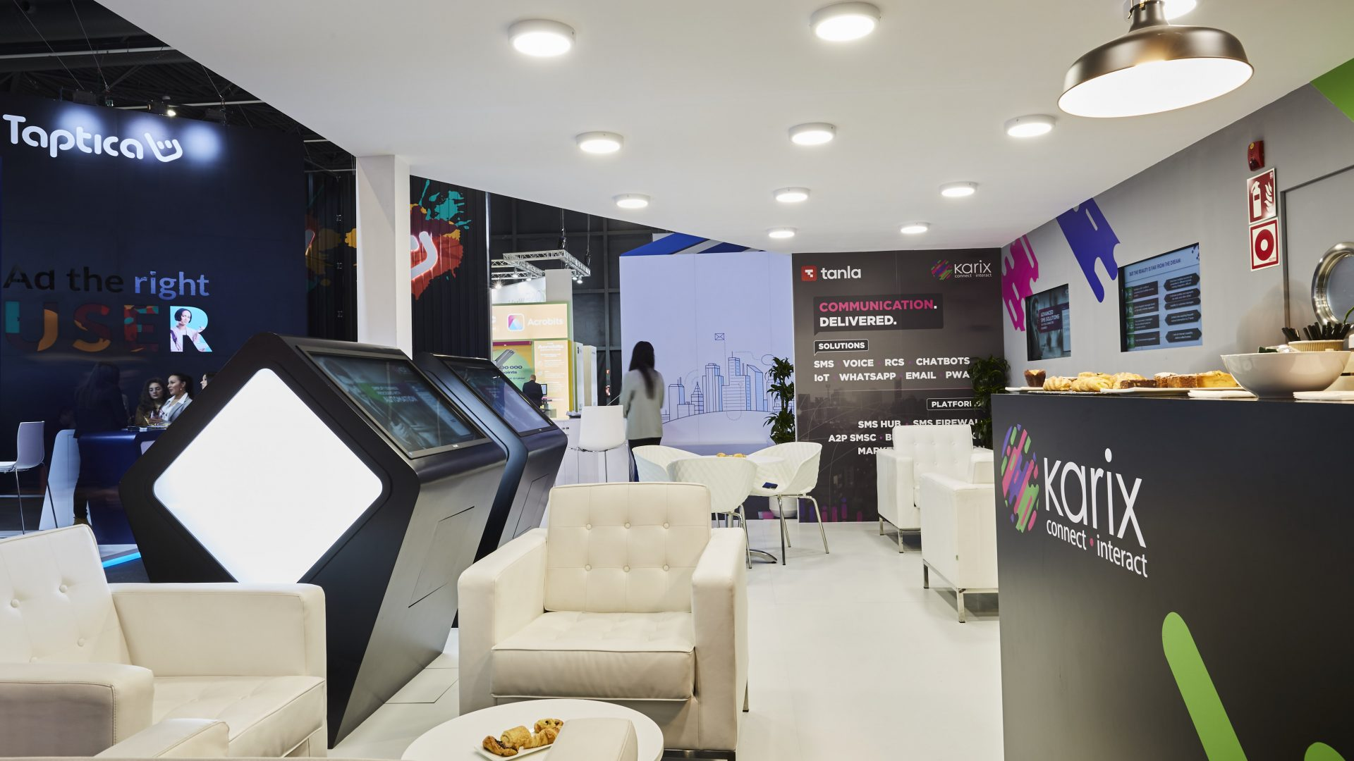 Karix stand at MWC 2019 - lounge area with bar and custom made demo stations