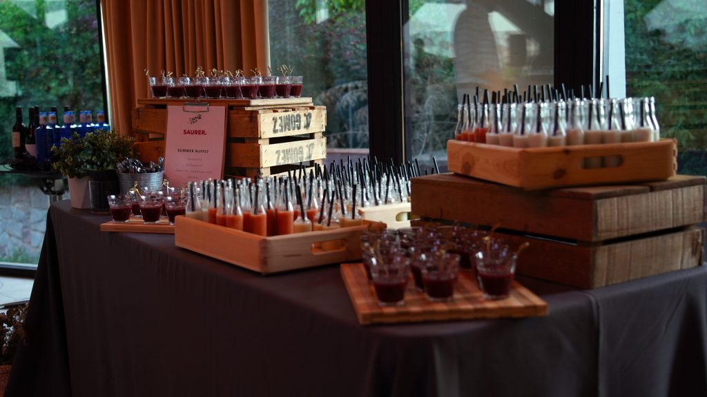 Catering station with finger food at a cocktail event in Barcelona