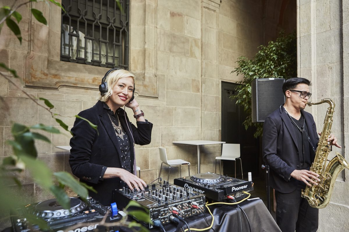 DJ and sax player performing at a corporate event in Barcelona
