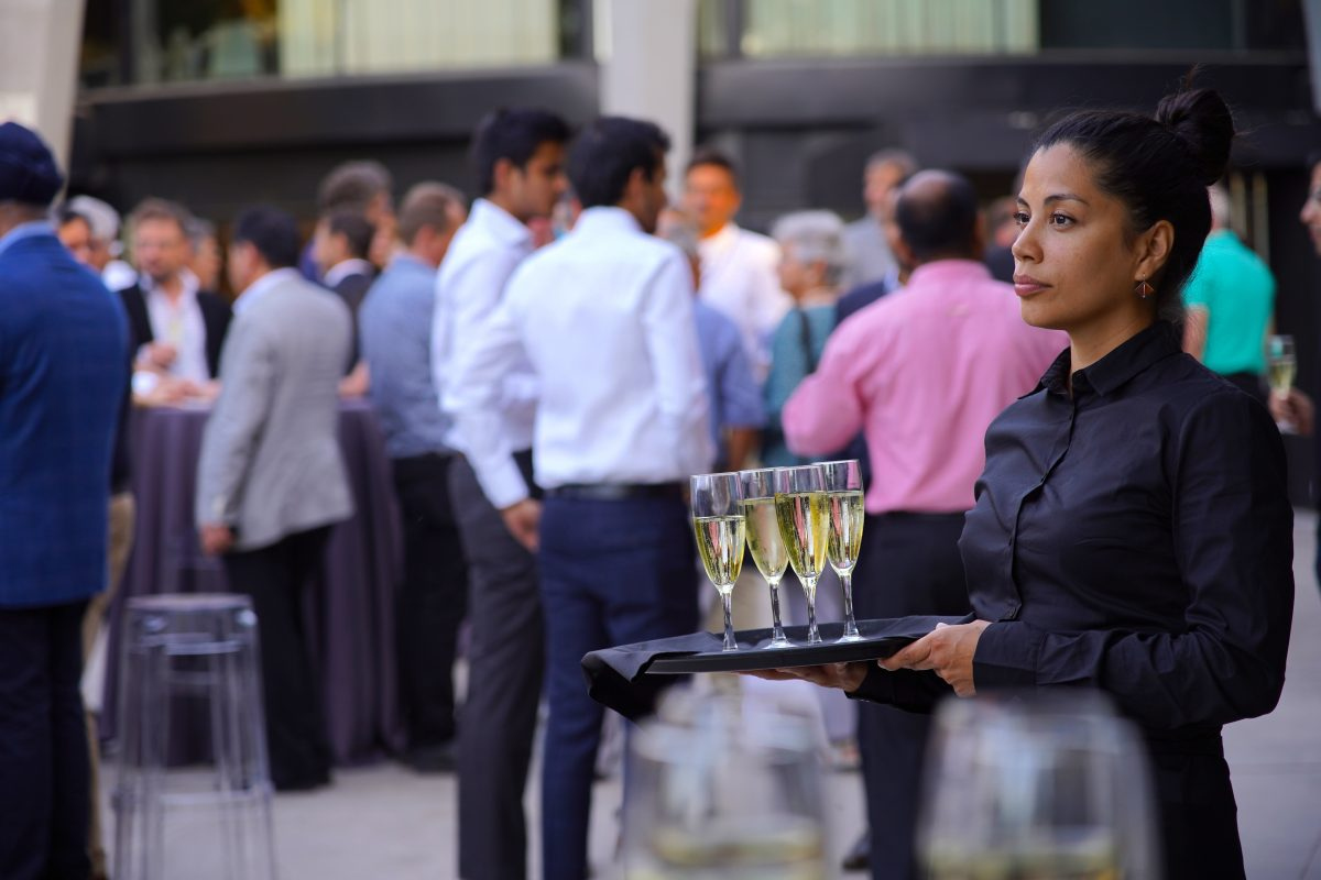 Champagne being served at an anniversary corporate party in Barcelona